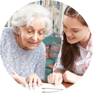 caregiver and elderly woman reading books