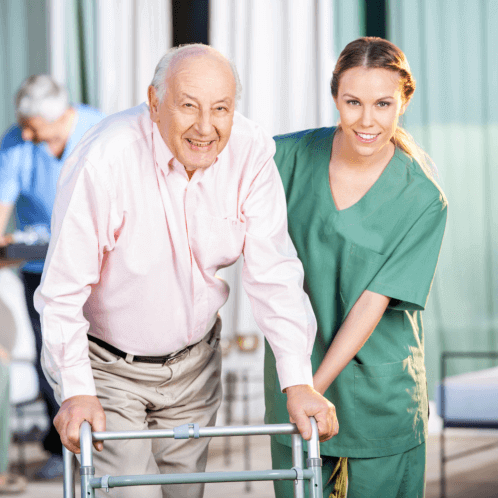 caregiver assisting an elderly man